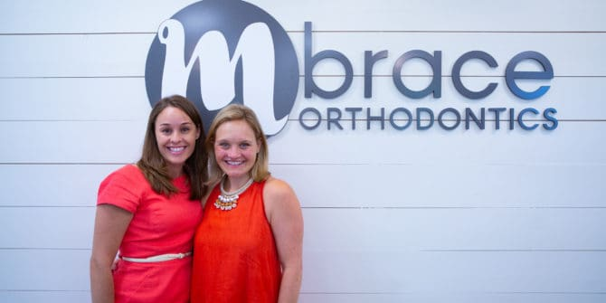 Mbrace Orthodontics Doctor Portraits 1 2 670x335 - Meet Our Orthodontists Dr. Meghann Dombroski & Dr. Tarryn MacCarthy